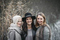 Portrait of three laughing friends in autumnal nature - HMEF00118