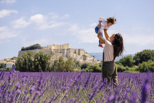 France, Grignan, mother and little daughter having fun together in lavender field - GEMF02591