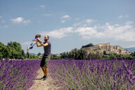 France, Grignan, father and little daughter having fun together in lavender field - GEMF02600