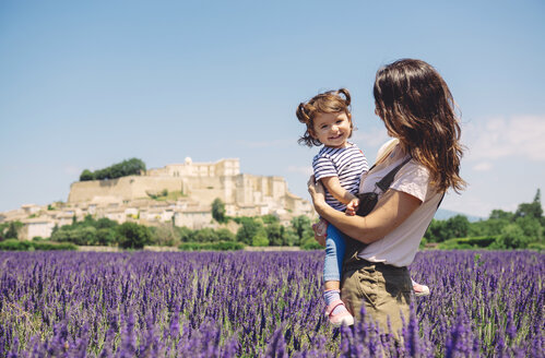 France, Grignan, portrait of happy baby girl together with her mother in lavender field - GEMF02624