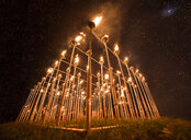 Low angle view of fire poles against star field during Yi Peng Festival - CAVF56781