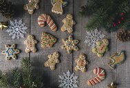 Overhead view of decorated gingerbread cookies on wooden table - CAVF56943