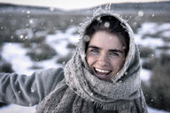 Close-up portrait of cheerful woman during winter - CAVF57358