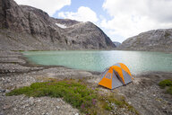 High angle view of tent on lakeshore against sky - CAVF57406