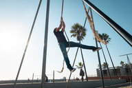 USA, California, Los Angeles, Venice, Man on the rope at Muscle Beach - SEEF00051