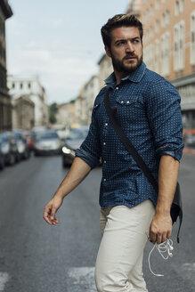 Italy, Rome, businessman crossing the street - BOYF01119