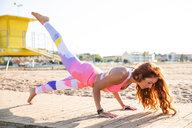 A woman practising yoga - INGF08098