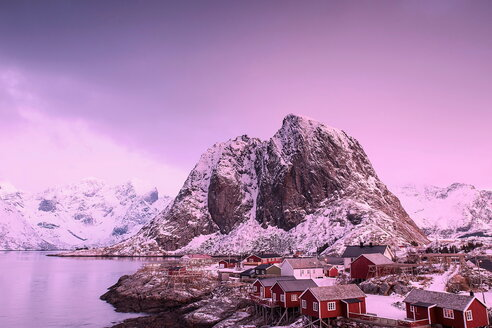 Scenic view of snow capped mountains under a purple sky during sunset - INGF08113