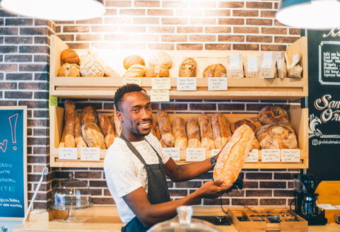 A smiling man working in a pastry shop - INGF08116