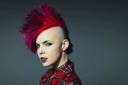 Portrait confident, cool young woman with pink mohawk - CAIF22355