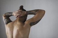 Rear view bare chested hipster man with tattoos - CAIF22382