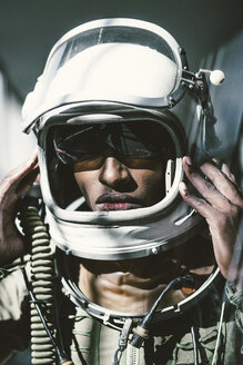 Portrait of serious astronaut in spacesuit - JCMF00017