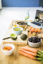 Healthy fruits and vegetables on a kitchen surface - MOEF01708