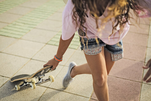 Girl with skateboard, copy space - ERRF00218