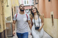 Spain, Andalusia, Malaga, tourist couple exploring the city - JSMF00613