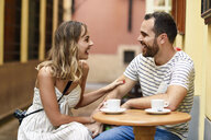 Spain, Andalusia, Malaga, happy couple having a coffee in an alley - JSMF00616
