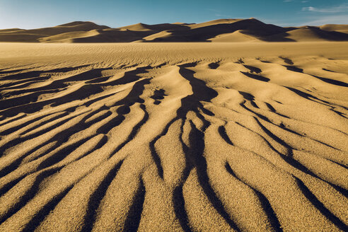 Tranquil view of wave pattern on sand at Great Sand Dunes National Park against sky - CAVF57940