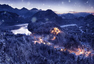 Germany, Hohenschwangau, view to lighted Neuschwanstein castle at snowfall and blue hour - FC01669