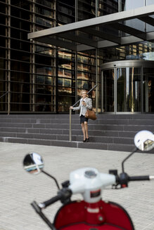 Senior businesswoman leaving office building - MAUF01819