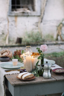 Laid garden table with candles - ALBF00706