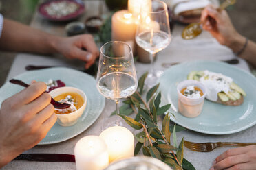 Close-up of couple having a romantic candelight meal outdoors - ALBF00727