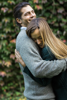 Happy affectionate couple hugging outdoors - ALBF00751