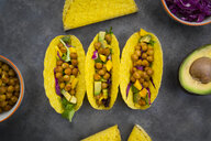 Vegetarian tacos with curcuma, roasted chickpeas, paprika, avocado, salad and red cabbage - LVF07578
