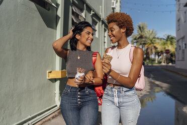 USA, Florida, Miami Beach, two happy female friends with ice cream cones in the city - BOYF01220