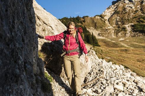 Woman mountain hiking in rocky terrain - UUF16007