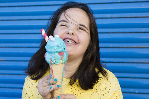 Teenager girl with down syndrome enjoying an ice cream - ERRF00272