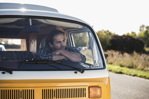 Young man on a road trip with his camper, taking a break, relaxing - UUF16160