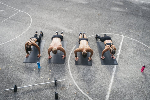 Sporty team during workout, pushups - HMEF00158