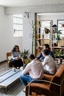 Business team having a discussion in loft office - GIOF04961