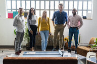 Portrait of confident business team in loft office - GIOF04982