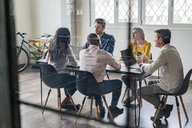 Business team having a meeting in loft office - GIOF04997