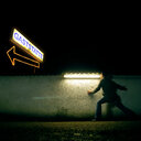 Man hiding behind  a small wall with lights - INGF08704