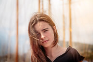 Portrait of a beautiful young woman with long hair in Barcelona - INGF08770