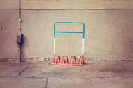 An empty bicycle rack against a wall - INGF08773