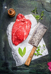 High angle view of raw meat on a rustic background - INGF08797