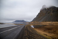 Scenic nature shot of a winding road amidst mountains in Iceland - INGF08917
