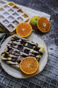 High angle view of waffles with oranges on table - CAVF58862