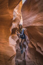 Carefree female hiker amidst canyons - CAVF58868