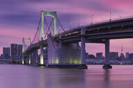 Rainbow bridge and Tokyo tower against sky during sunset - CAVF58961