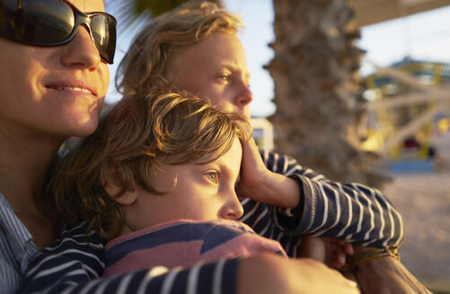 Mother with two sons on the beach at sunset - SSCF00082