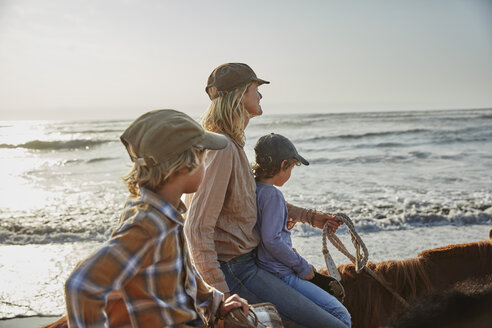 Chile, Vina del Mar, mother with two sons riding horses on the beach - SSCF00115