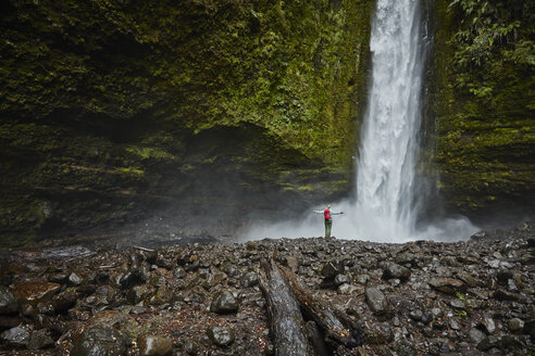Chile, Patagonia, Osorno Volcano, woman admiring Las Cascadas waterfall - SSCF00166