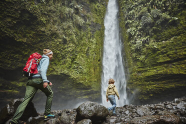 Chile, Patagonia, Osorno Volcano, mother and son walking at Las Cascadas waterfall - SSCF00169