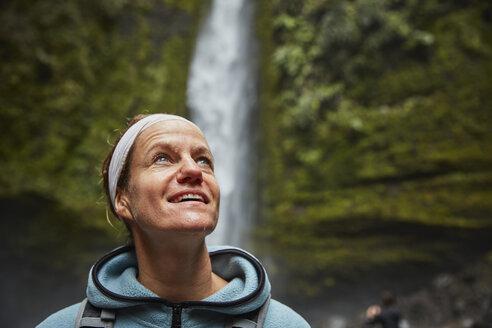 Chile, Patagonia, Osorno Volcano, portrait of woman admiring Las Cascadas waterfall - SSCF00172
