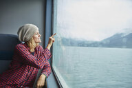 Chile, Hornopiren, woman drawing a heart on the window of a ferry - SSCF00199