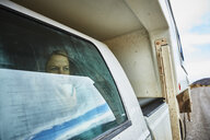 Chile, Valle Chacabuco, Parque Nacional Patagonia, woman looking out of window in camper - SSCF00247